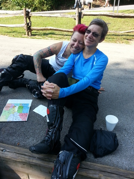Daughter and mother riders, Lyndse and Rachelle, pre-ride planning.